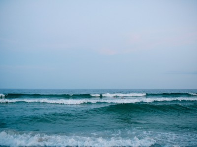 Waves roll into shore and nothing holds them back